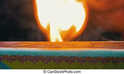 Ignition Match on Matchbox. Slow Motion in 96 fps. Macro...