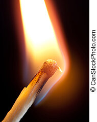 ignition of match - ignition of a match, with smoke on dark...