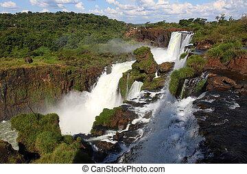 Iguassu waterfalls on a sunny day early in the morning. The...