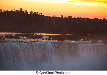 Iguazu falls - Sunset at famous Iguazu falls on the border...