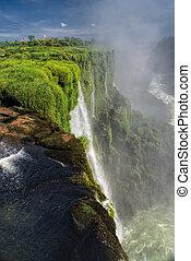 Iguazu falls - Dramatic view of Iguazu waterfalls in...