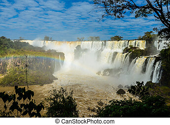 Iguazu waterfalls on a sunny day with the rainbow. Argentina side.