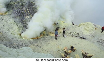 Sulfur miners inside crater of Ijen volcano in East Java, Indonesia timelapse.