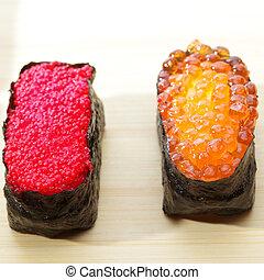 Ikura and Tobiko sushi closeup photo