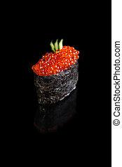 Ikura Sushi - Gunkan Maki Sushi with red caviar on a black ...