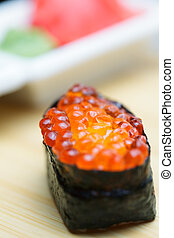 Ikura sushi with ginger and wasabi on background