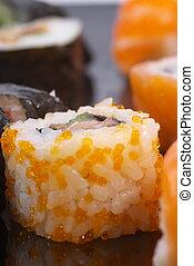 Ikura sushi with tuna inside.