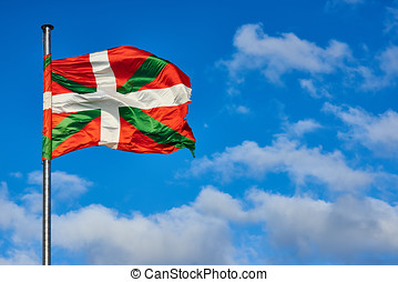 ikurrina, basque, pays, onduler drapeau, sur, a, bleu, sky.