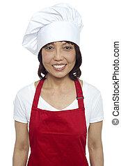 il portare, grembiule, giovane chef, femmina, sorridente, rosso