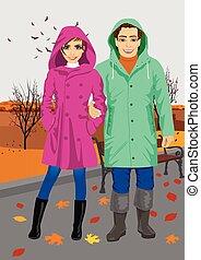 il portare, standing, coppia, parco, giovane, autunno, raincoats