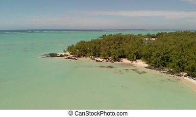 Ile Aux Cerfs in Mauritius. Panoramic aerial view of beautiful coastline from a drone.