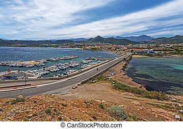 Ile-Rousse landscape seen from Pietra Islet in Corsica. The ...