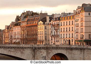 Facades of apartment buildings at Ile Saint Louis and Pont de la Tournelle bridge, Paris, France