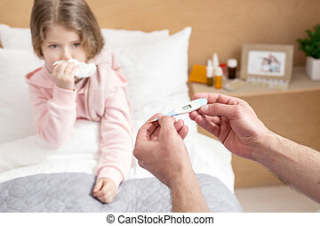 Ill child having a high fever