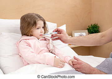 Ill child having a thermometer in her mouth