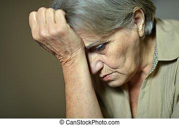 Ill elderly woman - Close-up of ill elderly woman touching...