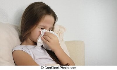 ill girl with paper tissue on the bed - healthcare and...