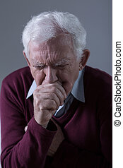 Ill man coughing - Vertical view of ill senior man coughing