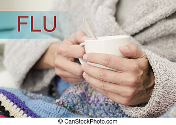 ill man with a cup of soup and the word flu