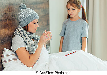 ill mother and child in bedroom