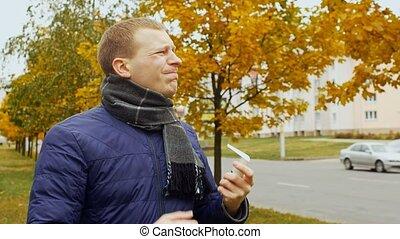 ill or sick man uses spray aerosol against a sore throat due...