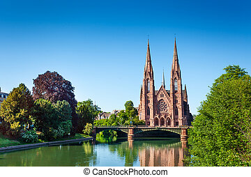 Ill river bank and Saint Paul Church in Strasbourg - ...
