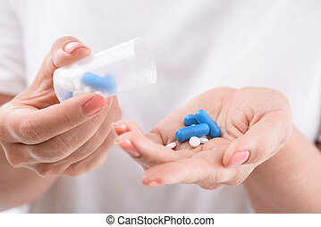 Ill senior lady taking medicine