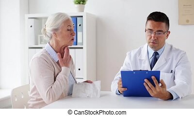 ill senior woman and doctor meeting at hospital - medicine,...