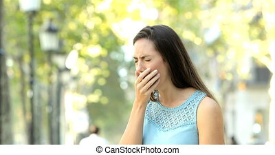 Ill woman coughing in the street - Ill woman coughing...