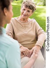 Ill woman with caregiver