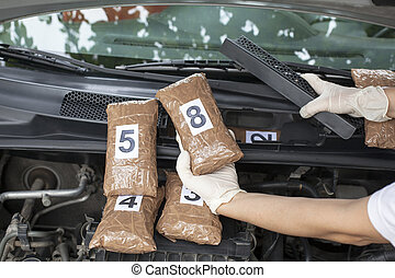 Illegal drug trade - Hidden drugs in a vehicle compartment