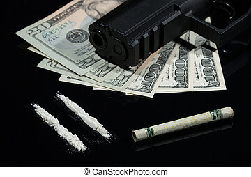 Illegal drugs , money and guns - Close up shot of cocaine,...