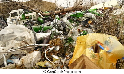 Illegal dumping site with household garbage. Rubbish dumped...