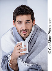 illness man wrapped in blanket