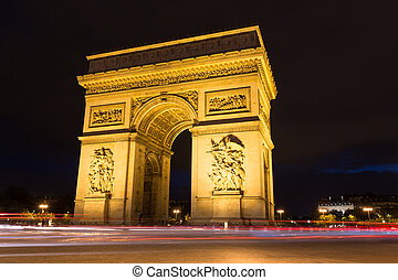 Evening view of illuminated Arc de Triomphe with light rails of passing traffic in Paris, France