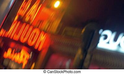 Illuminated banners in night street, defocus - Defocused...