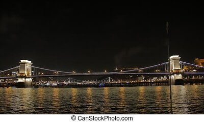 Illuminated bridge at night old Szechenyi Chain Bridge Budapest Hungary view from the river Danube