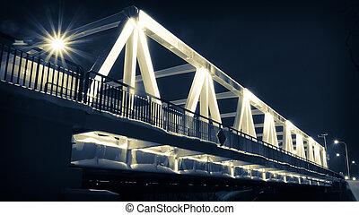 Illuminated bridge at night in winter