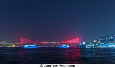 "Illuminated bridge over Bosphorus night timelapse. Turkey renames Bosporus Bridge ""15th July Martyrs Bridge"". Istanbul Turkey."