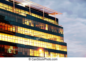 Illuminated building - An illuminated building at night. ...