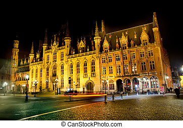bruges at night - illuminated building in bruges at night