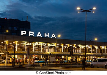 Illuminated building of Terminal 1 of Vaclav Havel Airport Prague at twilight, Czech Republic