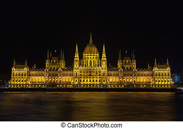 Illuminated building of the Hungarian Parliament in Budapest at night on the Danube River
