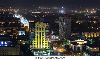 Illuminated builrings and traffic on the roads timelapse from rooftop at night in Astana. Kazakhstan capital