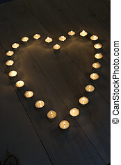 Illuminated Candles Placed In A Heart Shape