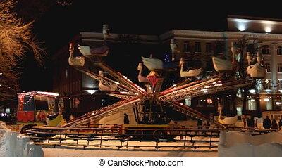 illuminated carousel at winter