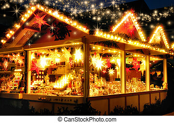 Illuminated Christmas fair kiosk with loads of shining ...