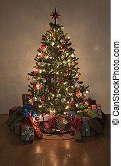 illuminated christmas tree with presents