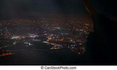 Illuminated city night airplane