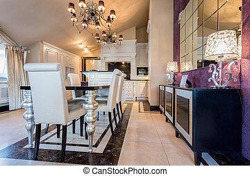 Illuminated dining room interior in luxury mansion